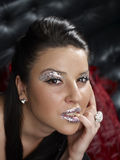 Mujer con maquillaje glittery Imagen de archivo