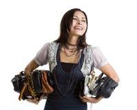 Mujer con muchos monederos Imagen de archivo