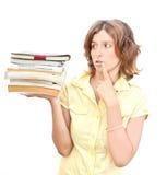 Mujer con pegado de libros sobre blanco Imagen de archivo libre de regalías