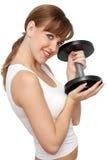Mujer con pesa de gimnasia grande Imagen de archivo libre de regalías