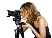 mujer con photocamera y el trípode Fotografía de archivo