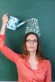 Mujer con preguntas múltiples Fotos de archivo