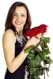 Mujer con rosas Foto de archivo libre de regalías