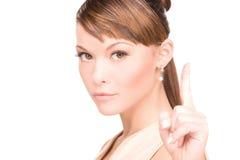 Mujer con su dedo para arriba imagen de archivo libre de regalías