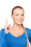 Mujer con su dedo para arriba Fotografía de archivo libre de regalías