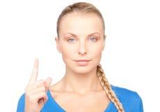 Mujer con su dedo para arriba Foto de archivo libre de regalías