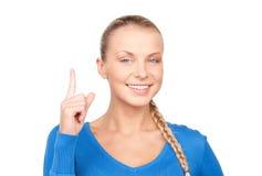 Mujer con su dedo para arriba Imagenes de archivo