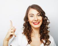 Mujer con su dedo para arriba Imágenes de archivo libres de regalías