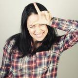 Mujer con su dedo para arriba Fotos de archivo libres de regalías