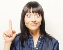 Mujer con su dedo para arriba ¡Buena idea! Imágenes de archivo libres de regalías