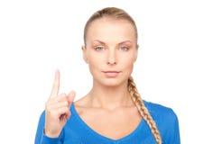 Mujer con su finger para arriba Imágenes de archivo libres de regalías