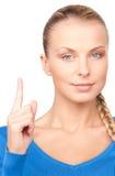 Mujer con su finger para arriba Imagen de archivo libre de regalías
