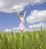 Mujer con sus brazos levantados Fotos de archivo libres de regalías