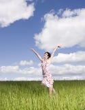 Mujer con sus brazos levantados Foto de archivo libre de regalías