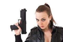 Mujer con un arma Imagen de archivo libre de regalías