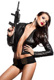 Mujer con un arma en manos Fotos de archivo libres de regalías