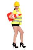 Mujer con un cono del tráfico Fotografía de archivo libre de regalías