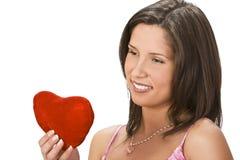 Mujer con un corazón rojo Fotos de archivo