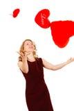 Mujer con un corazón rojo en un fondo blanco Imagen de archivo