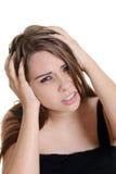 Mujer con un dolor de cabeza de la jaqueca Imagen de archivo