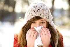 Mujer con un frío Imagen de archivo