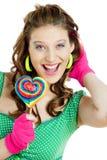 Mujer con un lollypop Fotografía de archivo libre de regalías