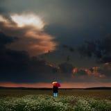Mujer con un paraguas Fotografía de archivo