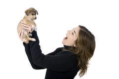 Mujer con un perrito Foto de archivo