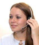 Mujer con un receptor de cabeza Imagen de archivo libre de regalías