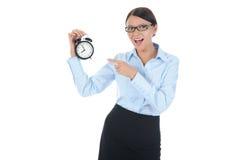 Mujer con un reloj de alarma en una mano. Fotos de archivo libres de regalías