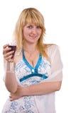 Mujer con un vidrio de vino. Foto de archivo