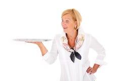 Mujer con una bandeja Imágenes de archivo libres de regalías