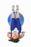 Mujer con una bola de la gimnasia Imágenes de archivo libres de regalías
