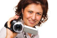 Mujer con una cámara de vídeo Fotos de archivo libres de regalías