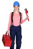 Mujer con una caja de herramientas Foto de archivo libre de regalías