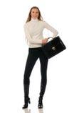 Mujer con una cartera en el fondo blanco Fotografía de archivo libre de regalías