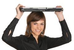 Mujer con una computadora portátil Fotos de archivo