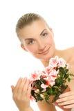 Mujer con una flor Imagen de archivo