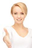 Mujer con una mano abierta lista para el apretón de manos Imágenes de archivo libres de regalías