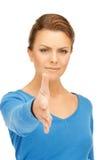 Mujer con una mano abierta lista para el apretón de manos Fotos de archivo