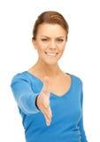 Mujer con una mano abierta lista para el apretón de manos Imagenes de archivo