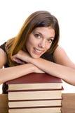 Mujer con una pila de libros Foto de archivo libre de regalías
