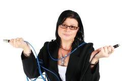 Mujer confusa con los cables Imágenes de archivo libres de regalías