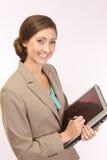 Mujer corporativa con una PC de la tablilla Imágenes de archivo libres de regalías