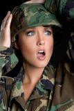 Mujer dada una sacudida eléctrica del ejército imágenes de archivo libres de regalías