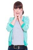 Mujer dada una sacudida eléctrica sobre el fondo blanco Imagen de archivo libre de regalías