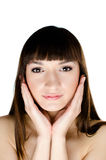 Mujer dark-haired hermosa que toca su cara Fotografía de archivo libre de regalías