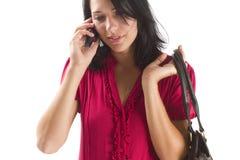 Mujer de carrera joven que habla en un teléfono celular Fotografía de archivo libre de regalías