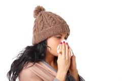 Mujer de estornudo foto de archivo libre de regalías