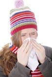 Mujer de estornudo con el pañuelo Foto de archivo